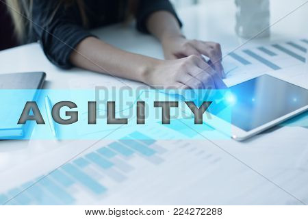 Agility text on virtual screen. Business technology and internet concept.