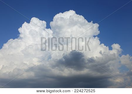 Thundercloud on a background of blue sky.