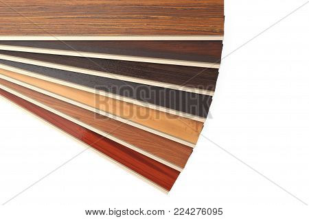 New Laminate Parquet Floor Planks of Different Colors on a white background. 3d Rendering.