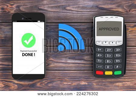 Wireless Payment Concept. Mobile Phone with POS Terminal and Wireless Sign on a wooden table. 3d Rendering.