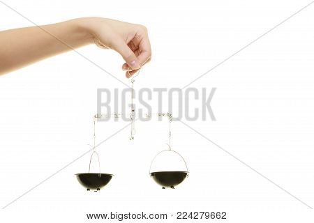 Law court concept. Female hand holds scales symbol sign of justice. isolated on white background