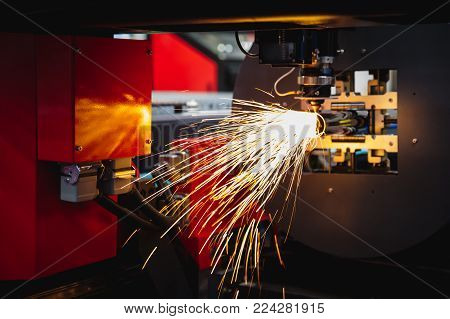 Cutting Of Sheet Metal. Sparks Fly From Laser By Automatic Cutting Cnc, Plc Machine. Fabricate Work,