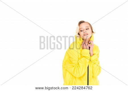 portrait of beautiful young woman in yellow raincoat isolated on white