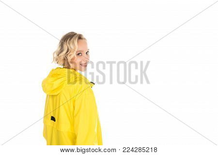 back view of beautiful young woman in yellow raincoat isolated on white