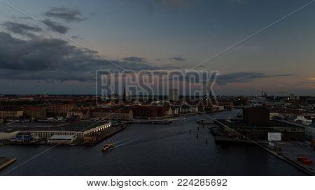 Copenhagen harbor at night. Paper Island and Royal Danish Playhouse. Harbor bus.