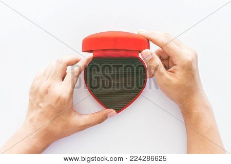 Hands hold a empty blank red heart gift box on white background