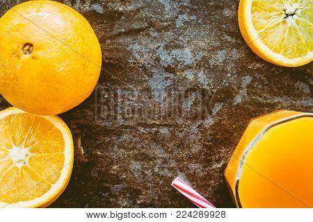 Fresh orange juice on  rustic stone background