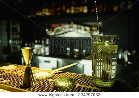 Alcohol bar, cocktail glass on bar counter, cocktail glass in a bar, Drinking cocktail in bar, cocktail in the glass with straws, Fresh drink coctail