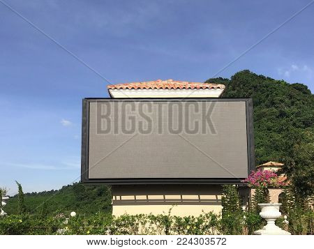 Outdoor advertising billboard LED for advertising with tree and mountain background