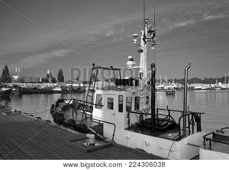 SEAPORT - Fishing port and Pilot Vessel moored at the wharf