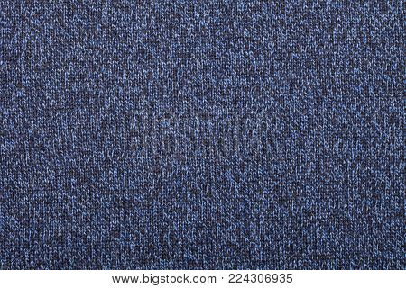 Blue knitted fabric made of yarn textured background