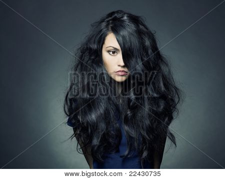 Photo of young beautiful lady with magnificent dark hair poster