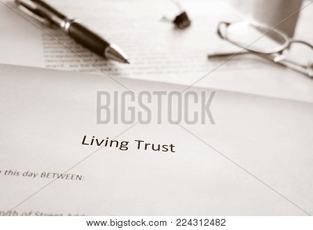 A Living Trust estate planning document with pen
