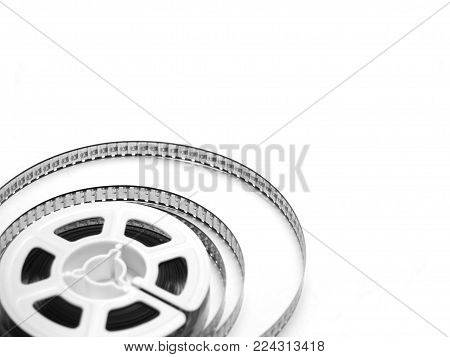 old 8 mm fil reels isolated on a white background.
