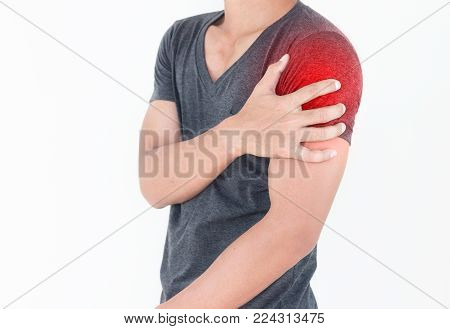 Young man suffering from pain the shoulder, Health Care Concept.