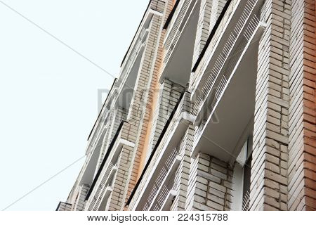 Part Of The Facade Of The Building With Plastic Spikes Against Pigeons. The Design Does Not Allow Bi