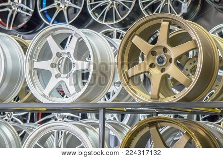 Shop shelves with automobile car alloy wheels.