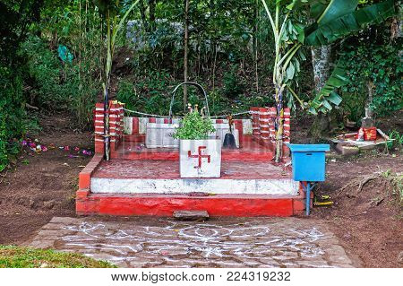 Small temple in Sri lanka. The swastika is an ancient religious icon used in the Indian subcontinent, East Asia and Southeast Asia, where it has been and remains a sacred symbol of spiritual principles in Hinduism, Buddhism and Jainism.