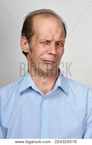 Portrait of young unhappy displeased man showing disgust