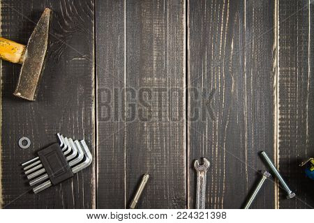 Joinery tools on a dark wooden table. Place for the text. A concept for Father's Day. Top view. Flat laying.