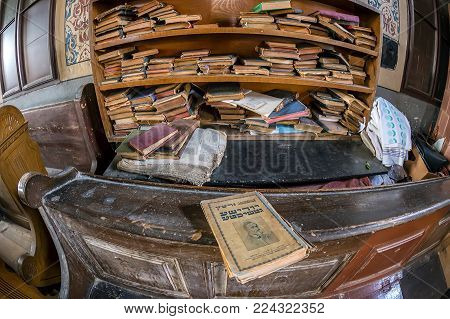 ORADEA, ROMANIA - JANUARY 27, 2018: Inside of one small Orthodox Synagogue with lots of books in the Hebrew language.