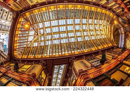 LONDON, ENGLAND - NOVEMBER 27, 2017: Old end new in London. Inside of the Leadenhall market, one of the oldest markets in London, dating back to the 14th century. Near is new Lloyd's Building.