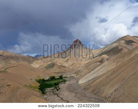 Views on high mountains from the route between the Srinagar city and the Leh city located in Ladakh. This region is a purpose of motorcycle expeditions organised by Indians