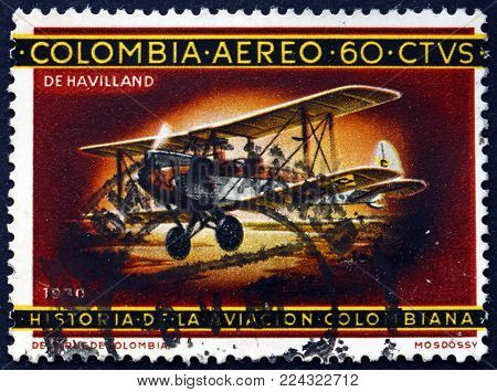 COLOMBIA - CIRCA 1965: a stamp printed in the Colombia shows De Havilland biplane, history of Colombian aviation, circa 1965
