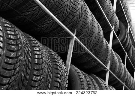 Rack with variety of car tires in automobile store