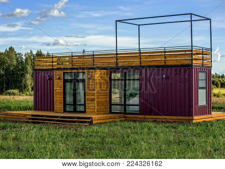 A modern design of a country home constructed from containers. Container houses.