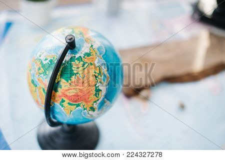 Still life on the political map of the world. The concept of travel.