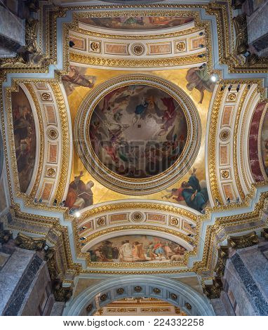 SAINT PETERSBURG, RUSSIA - AUGUST 15, 2017. Decorations of dome ceiling in the interior of the St Isaac Cathedral in Saint Petersburg, Russia. Interior panorama of Saint Petersburg Russia landmark