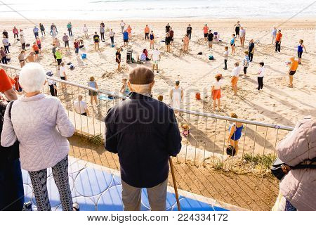 Benidorm, Spain, January 29, 2018: Elderly people doing exercises on the beach. Healthy lifestyle, active lifestyle retiree in Benidorm, Alicante, Spain