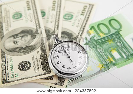 Time is money - stopwatch on bills. Concept.