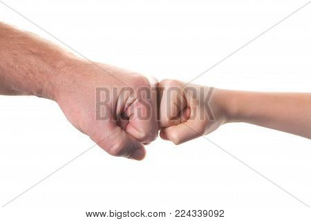 old man and kid holding hands together. isolated on white background
