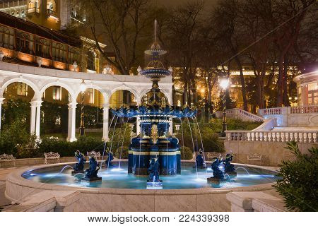 BAKU, AZERBAIJAN - DECEMBER 29, 2017: The old fountain in the former Governor's park (Vahid's Park) in night illumination