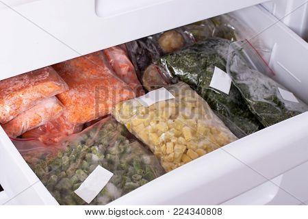 Assortment of frozenVegetables in home fridge. Frozen food in the freezer