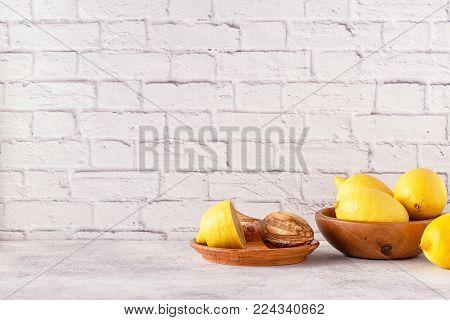 Lemons and juicer for making lemon juice. Copy space.