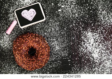 donut with chocolate  and heart drawing, copy space