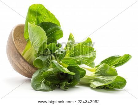 Fresh bok choy (Pak choi) out a wooden bowl isolated on white background
