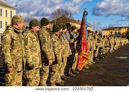 Uzhgorod, Ukraine - January 30, 2018: Soldiers of the 128th separate mountain infantry brigade lined up during their solemn meeting from the ATO zone.