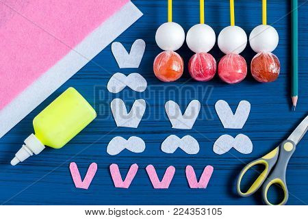 Making Easter bunny from lollipop. Sweet gift to children. Creative idea for children's party. DIY concept. Step by step photo instructions. Step 4. Cut ears and paws from felt