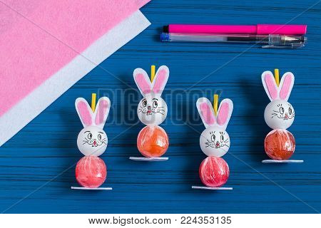 Making Easter bunny from lollipop. Sweet gift to children. Creative idea for children's party. DIY concept. Step by step photo instructions. Step 7. Draw hare's face