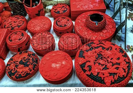 Red Chinese Ceramic Pots Panjuan Flea Market  Beijing China. Panjuan Flea Curio market has many fakes, replicas and copies of older Chinese products, many ancient.