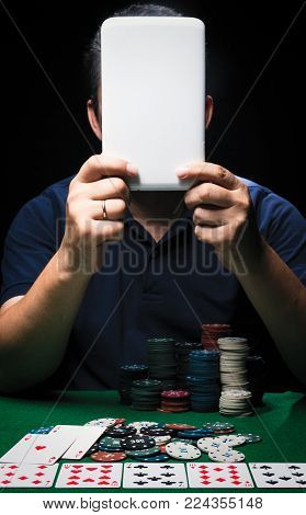 Man Is Playing Poker. Drink Whiskey, Man Holds Cards On Table, Winning All The Chips On Bank. Concep