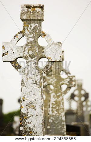 Ancient irish christian graveyard, tomb cross stones