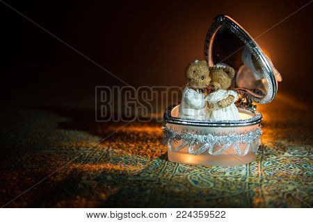 Love Concepts Of Wedding Teddy Bear In Silver Heart Gift Box On Table For Valentines Day And Wedding