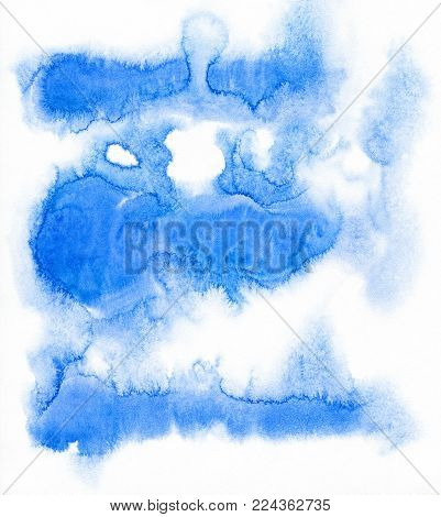Blue spots on watercolor paper. Abstract blue spot on white background. Ink drop.