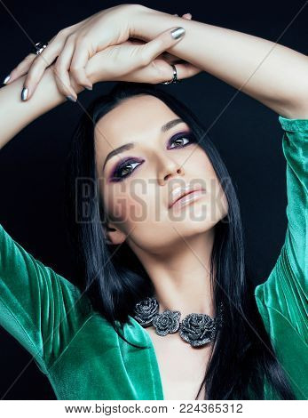 young pretty brunette woman fashion dressed, bright makeup, elegant hair style close up