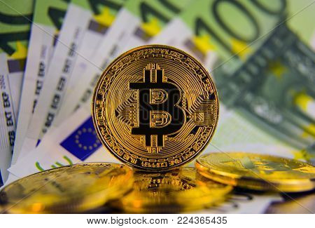 Golg coins bitcoin on euro banknotes background